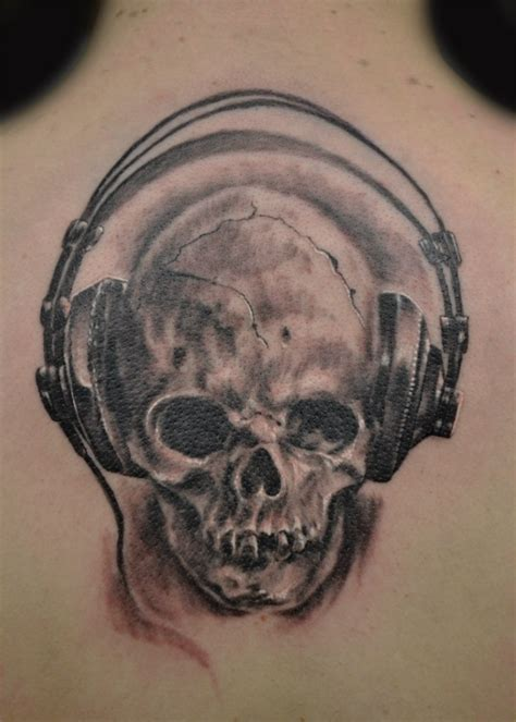 skull music tattoo designs skull that listens to heavy metal skull tattoos