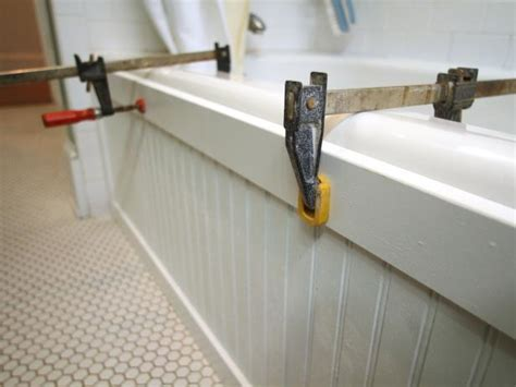 how to caulk a bathtub surround update a bathtub surround using beadboard hgtv