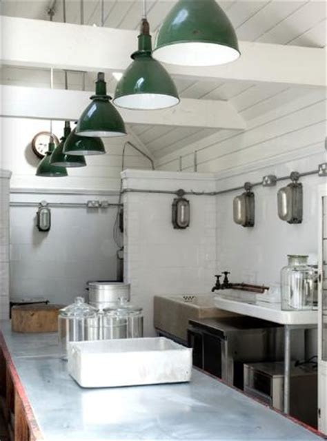 vintage barn pendants shine in industrial style kitchen