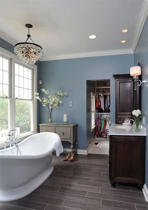 bathroom with grey floor grey wood floors blue walls and white trim basement