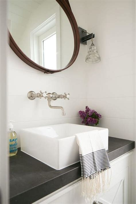 cottage powder room with leather captain mirror