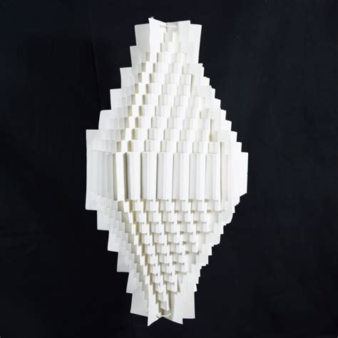 A Paper Lantern - white trapezoid geometrical shaped folding paper lantern