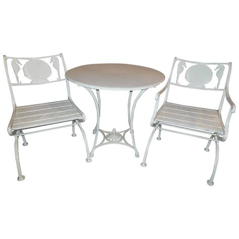 Cast Iron Bistro Chairs Bistro Set Cast Iron Table And Chairs With Shell And Sea Horses For Sale At 1stdibs