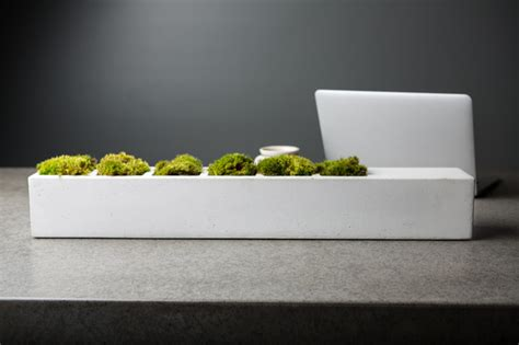bent steel and concrete table planter