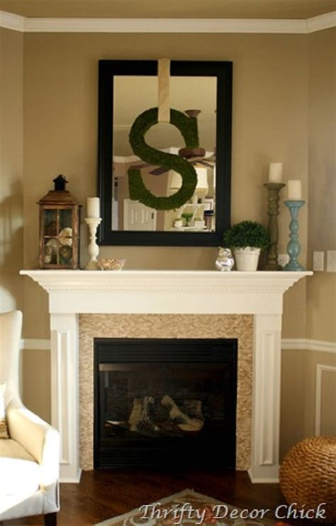 candles potted plant lantern framed mirror hanging initial mantle arrangement best