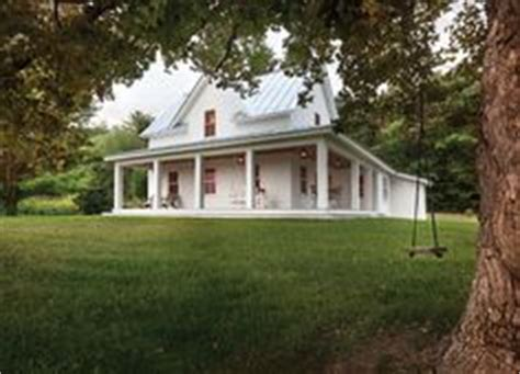 small country farmhouse with wrap around porch hip roof cape cod cottage with porches and a breezeway to detached