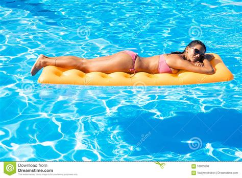Mattress In Pool by Sunbathing On Air Mattress In The Swimming Pool