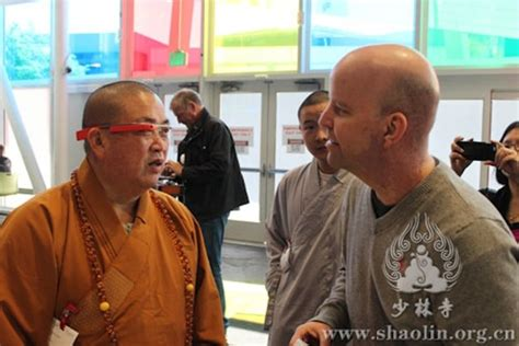 monk in the marketplace going to lead large books enlists bans shaolin monks to help glass look