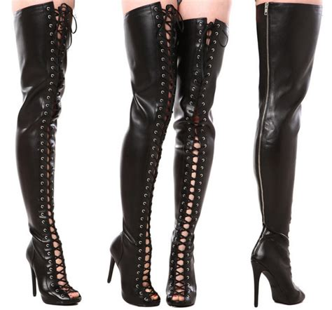 boasting black leather lace up thigh high boots
