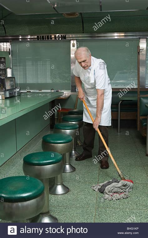man mopping stock  man mopping stock images alamy