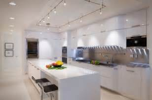 Cool track lighting installation above the kitchen island is a perfect