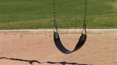 empty swing abandoned swing set at children s playground stock footage