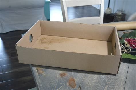cardboard box crafts for creating a simple storage bin using rope and a cardboard
