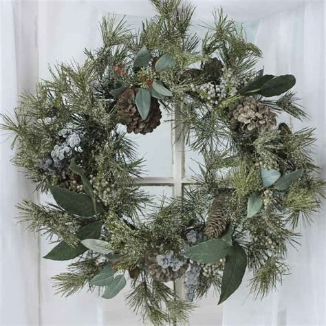 icy artificial pine and berry wreath christmas and