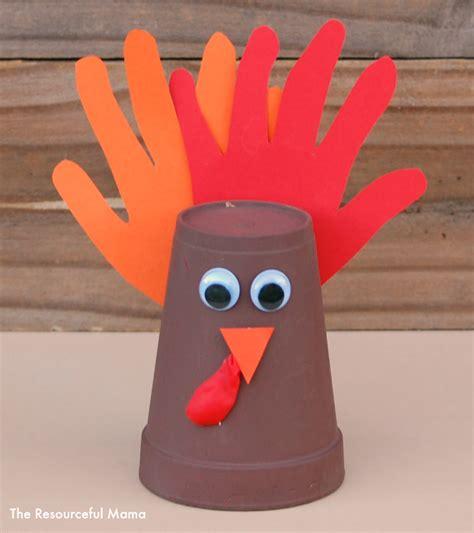 Paper Cup Turkey Craft - handprint turkey craft the resourceful