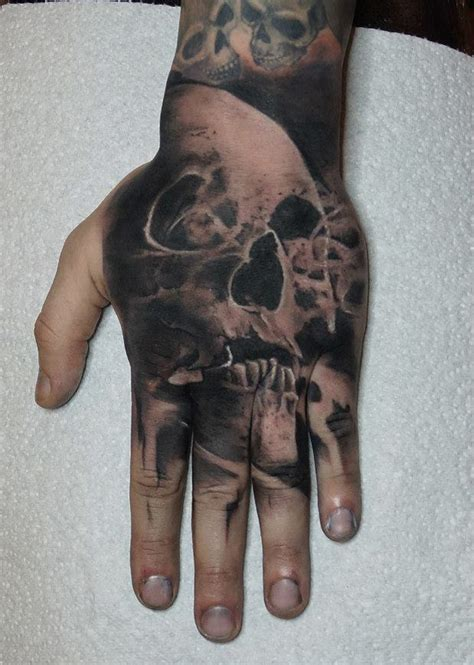 hand skull tattoo best tattoo design ideas