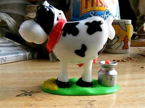 Now Thats A Dispenser by Pooping Cow Dispenser