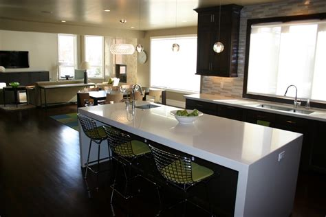 Furniture white granite countertop edges with iron chairs and dark wooden flooring plus pendant