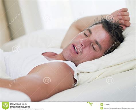 man sleeping in bed man lying in bed sleeping royalty free stock photography