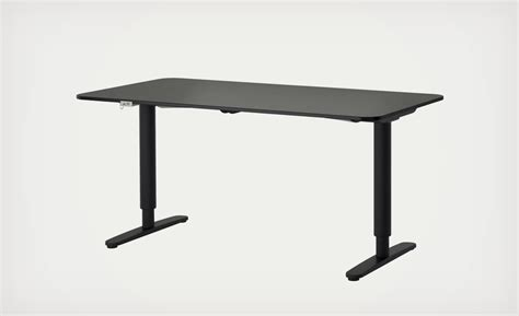 the ikea bekant sit stand desk adjusts with the press of a