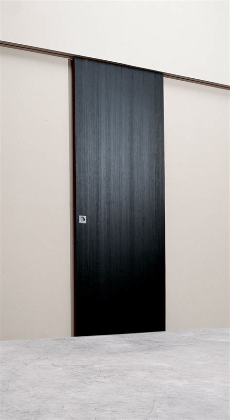 Sliding Wall Doors Interior Alluring Wall Sliding Doors Interior Design With Wooden Black Textured Doors Combined Brown Top