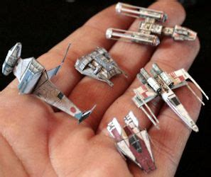 miniature wars ships and origami on