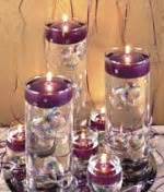 Round disc floating candles in glass cylinders with glass ornaments