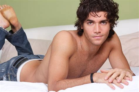 young boy lovely nud beautiful young man shirtless on bed stock photo image