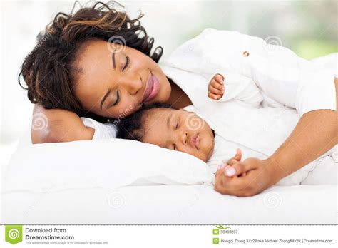 bed moms mother baby sleeping royalty free stock photography