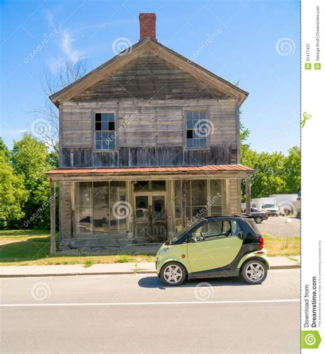 house of cars smart car in front of old wooden house royalty free stock photography image 31477437
