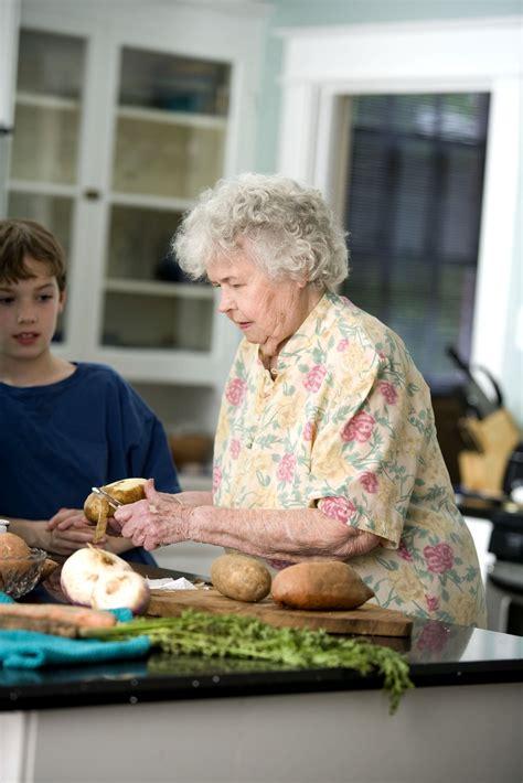 picture elderly woman grandson kitchen