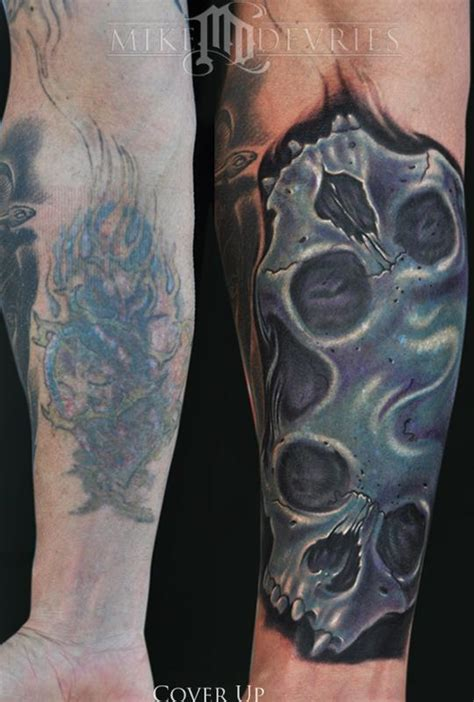 tattoo cover up with another tattoo skull cover up tattoo jpg