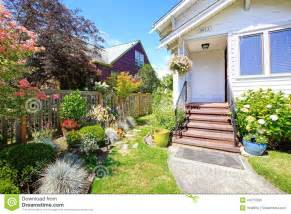 Curb Appeal Front Porch - simple house exterior entrance porch with stairs and flower bed stock photo image 44715609