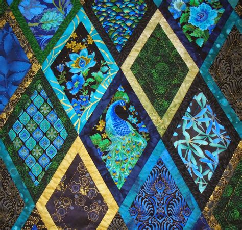 quilt pattern peacock wendy s quilts and more bordered diamonds becomes