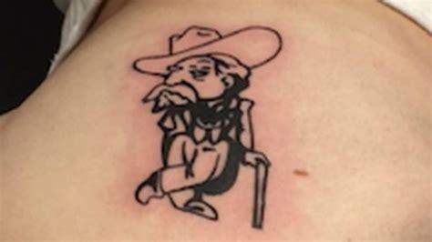 tattoo of us bum alabama fan loses bet gets ole miss butt tattoo ncaa