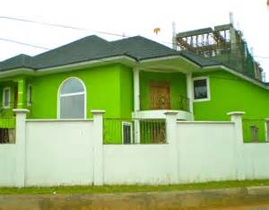 Modern bright green exterior wall paint color with dark roof color