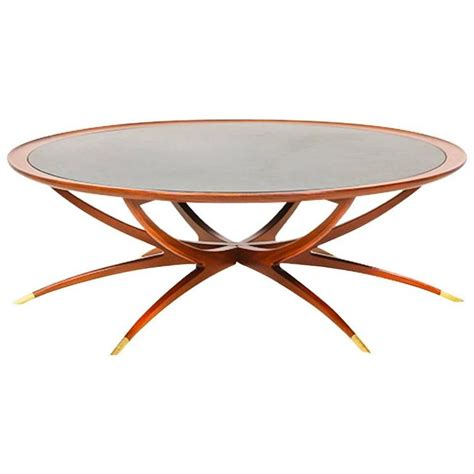 teak folding spider leg coffee table by selig at