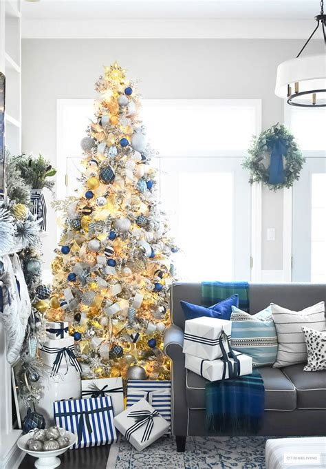 1996 blue room christmas tree flocked tree with navy light blue silver and gold ornaments tree
