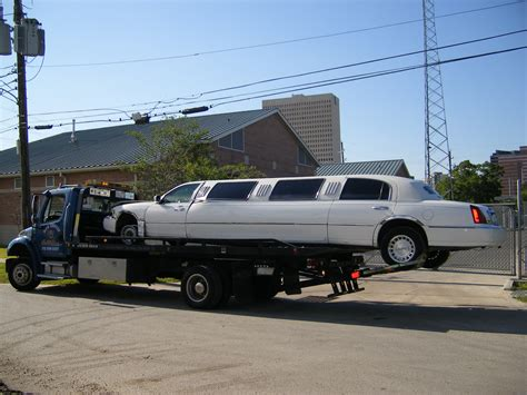 big limousine car containers specialzed movers flatbed towing small cars big