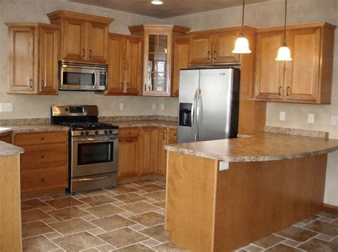 Does Flooring Go Cabinets by Tile Floors And Maple Cabinets Tile Floor With Oak