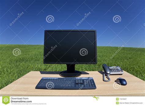 Desk In The Field by Desk And Computer In Green Field Royalty Free Stock