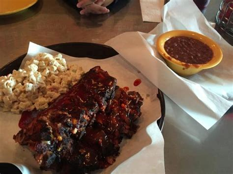 full rack of ribs with delicious side dishes picture of
