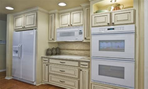kitchen with off white cabinets antique white kitchen cabinets with white appliances off