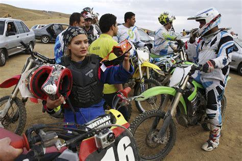women motocross in iran female motocross racer jumps barriers