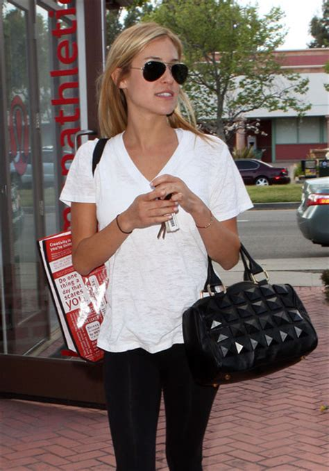 CELEBRITY STYLE: Kristen is seen here leaving an athletic store with a studded bowler bag.