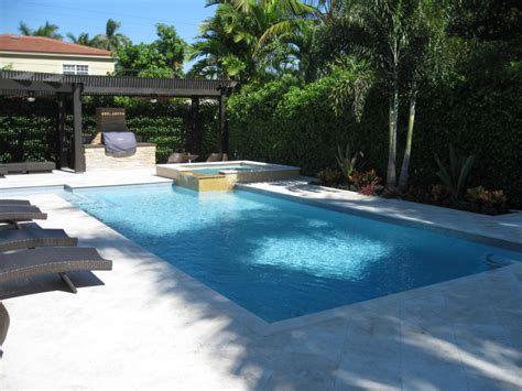 contemporary swimming pool with pedestal spa pool