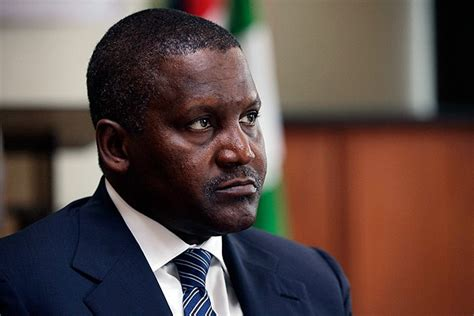 wants to buy arsenal and remove wenger dangote named africa s richest daily cannon