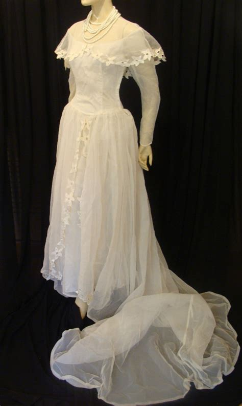 swing wedding dress 301 moved permanently