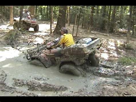 mudding four wheelers four wheeler in deep mud hole doovi