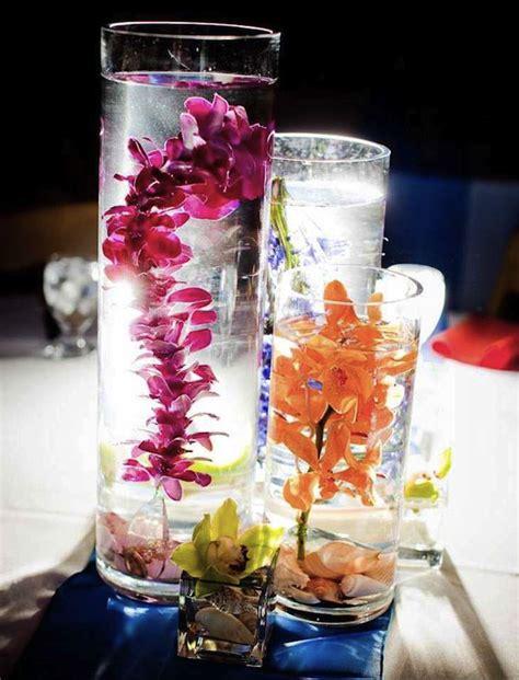 water vase centerpieces submerged orchids make great wedding centerpieces wedding reception flowers